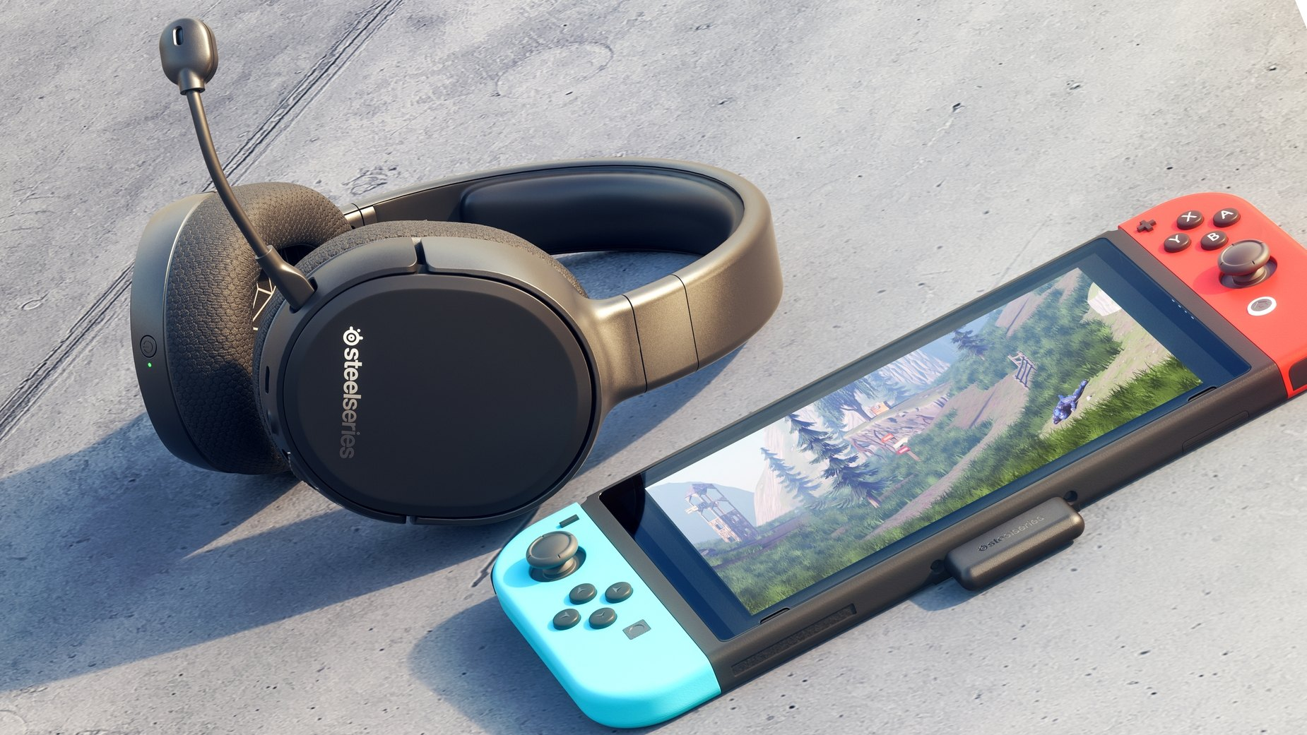 Arctis 1 Wireless for Switch gaming headset on surface next to a Swtich, connected via the wireless dongle.