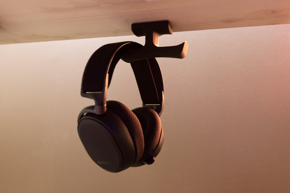 Under-desk headphone hanger attached to desk