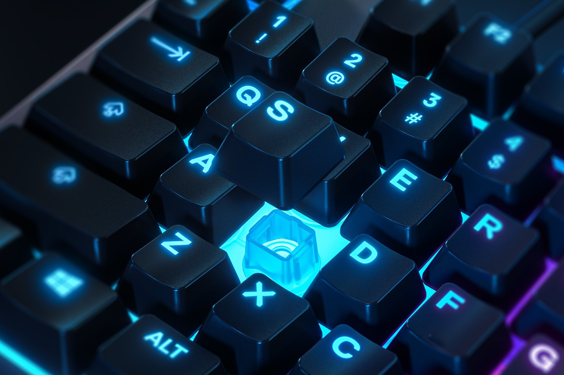Zoomed in view of a single key on the Apex 3 gaming keyboard, the key is raised up to show the SteelSeries Whisper-Quiet Switch underneath