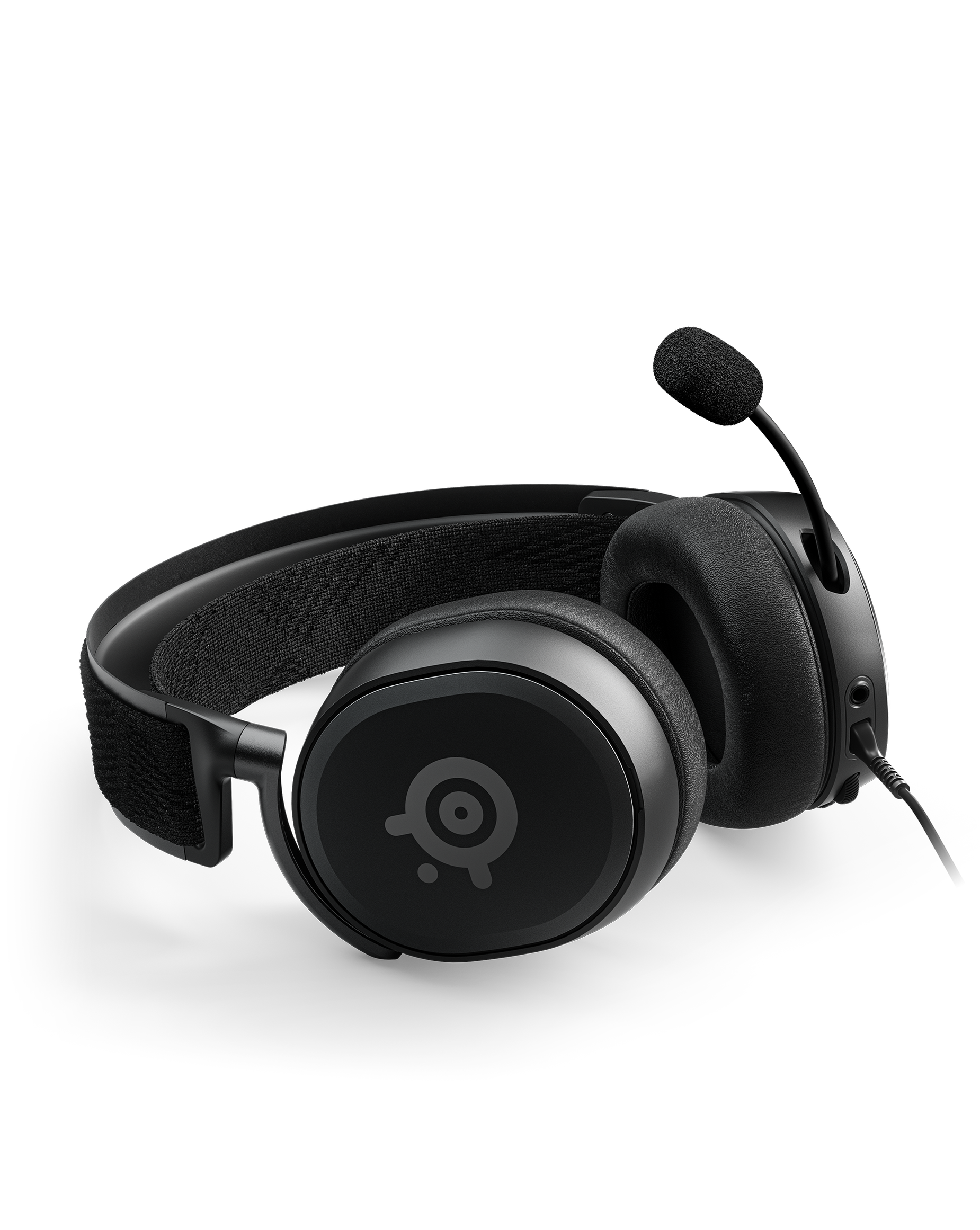 An Arctis Prime lays on its side with the mic fully extended.