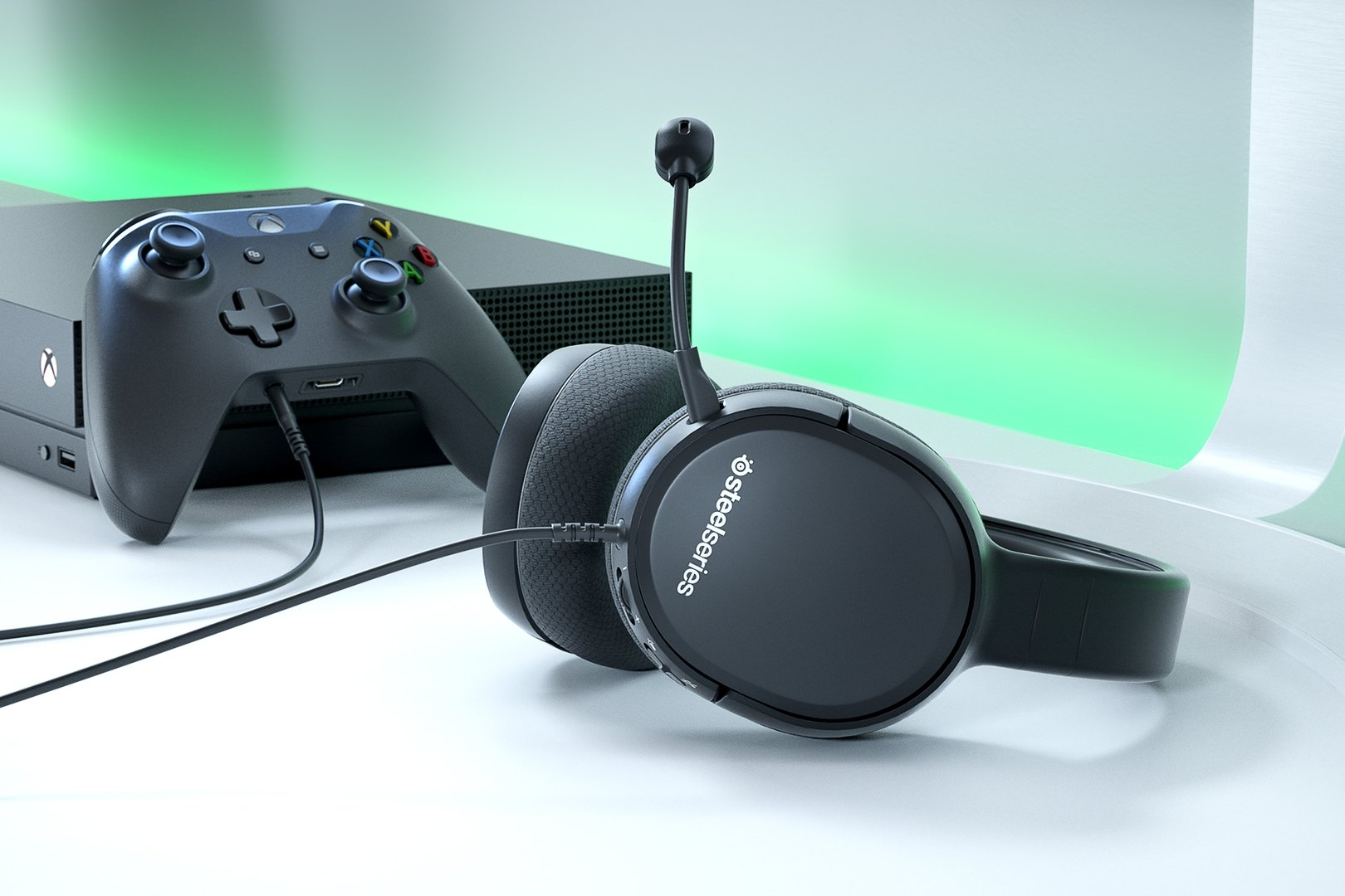 Arctis 1 for Xbox gaming headset on table with Xbox game console next to it