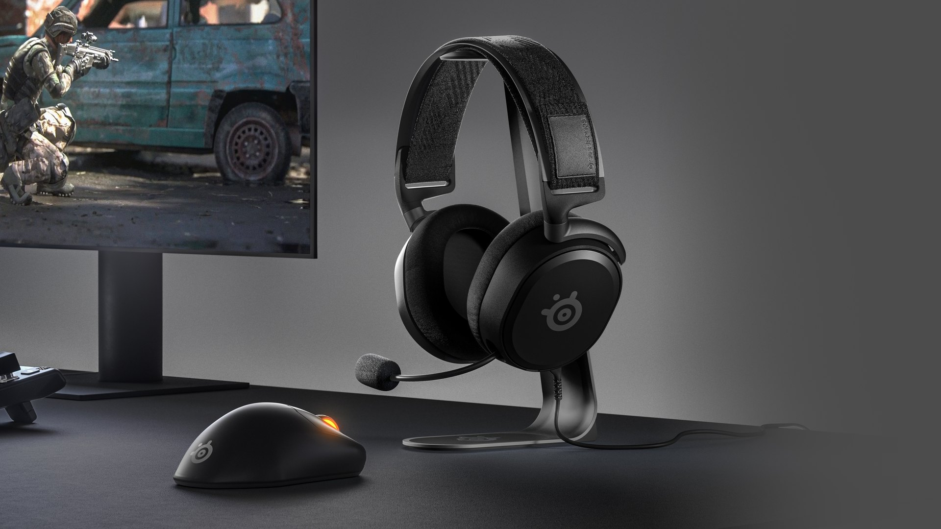 A sleek desktop setup with an Arctis Prime headset and Prime Wireless mouse.