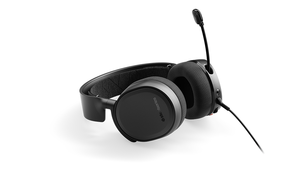 Arctis 3 - Black gaming headset laying flat with microphone in extended position