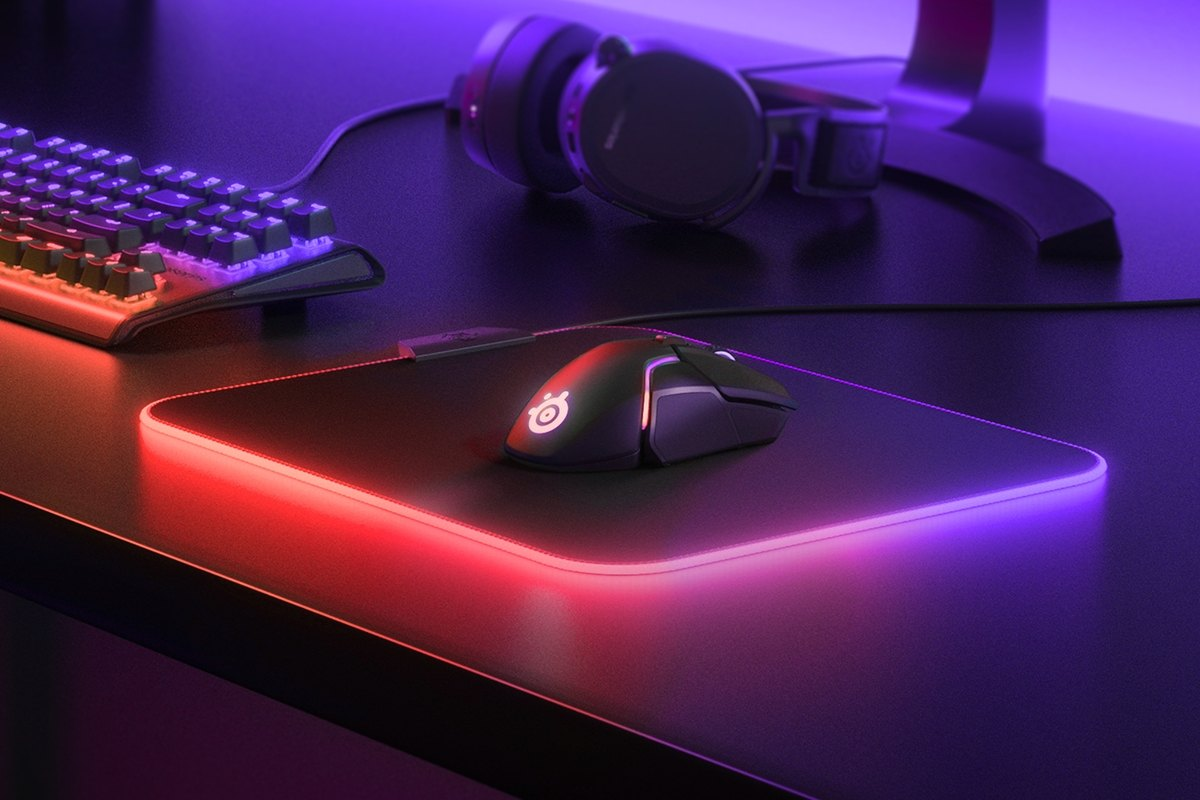 QcK Prism Medium gaming mousepad with RGB on edges with mouse on top