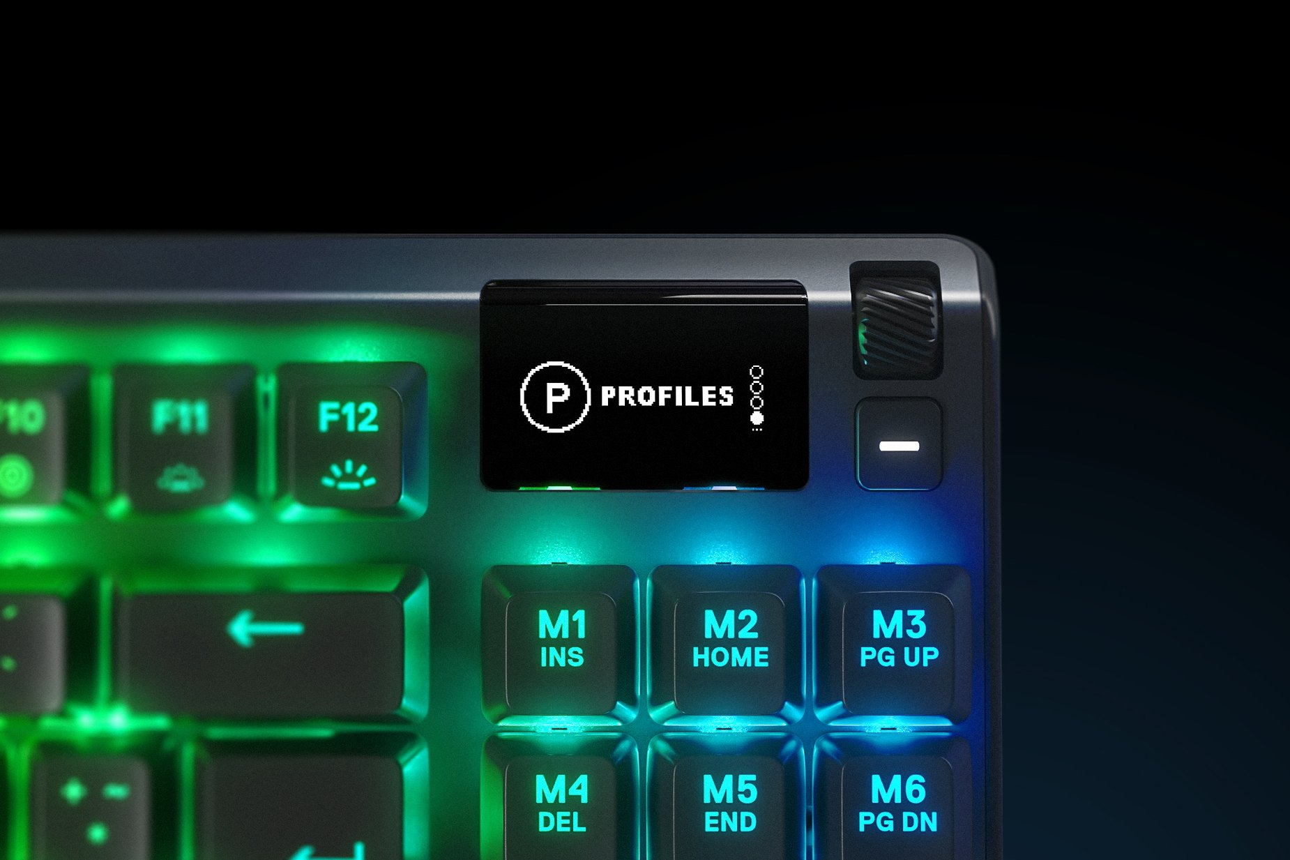 Zoomed in view of the multimedia and settings controls/volume roller on the French - Apex Pro TKL gaming keyboard