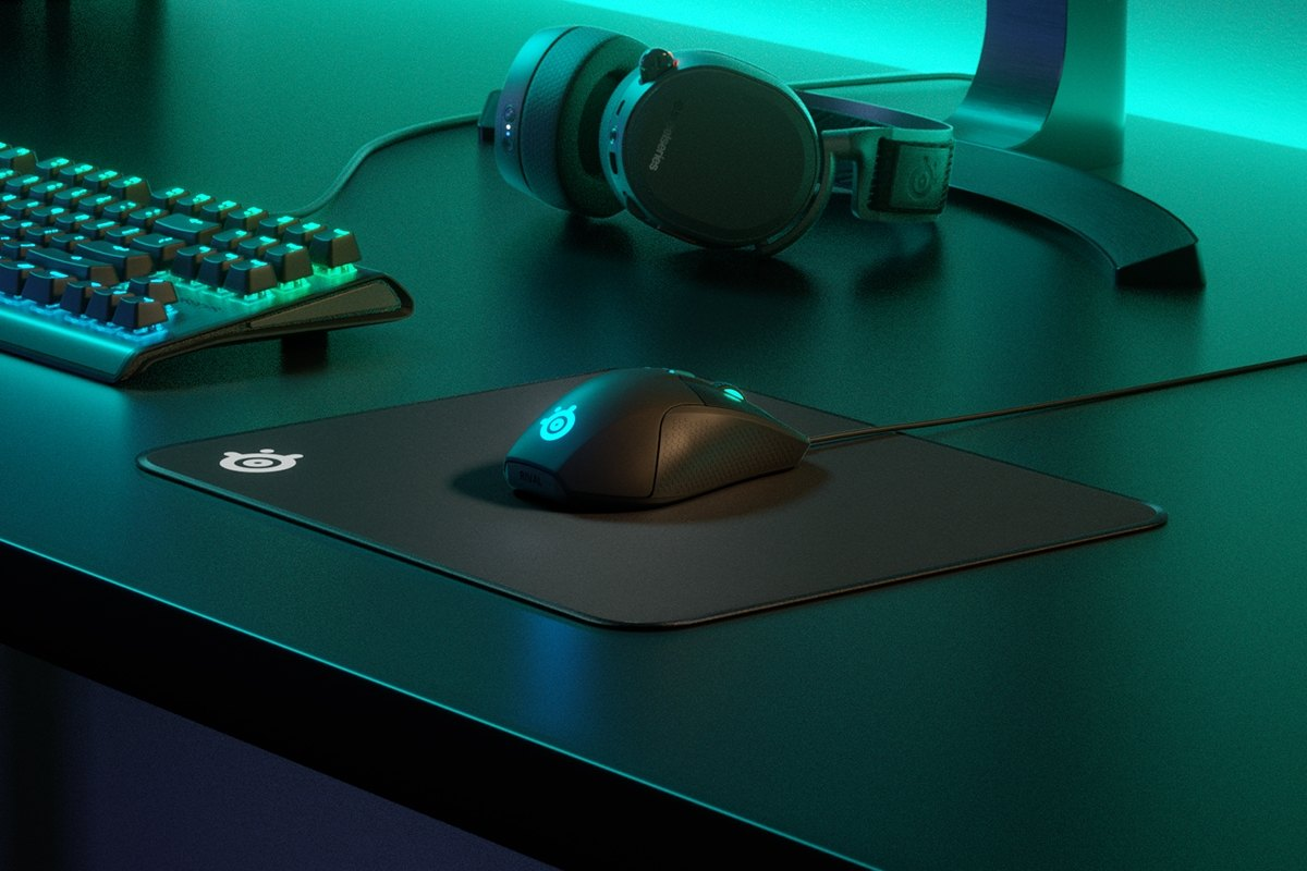 QcK Edge M on desk with mouse, headset, and monitor