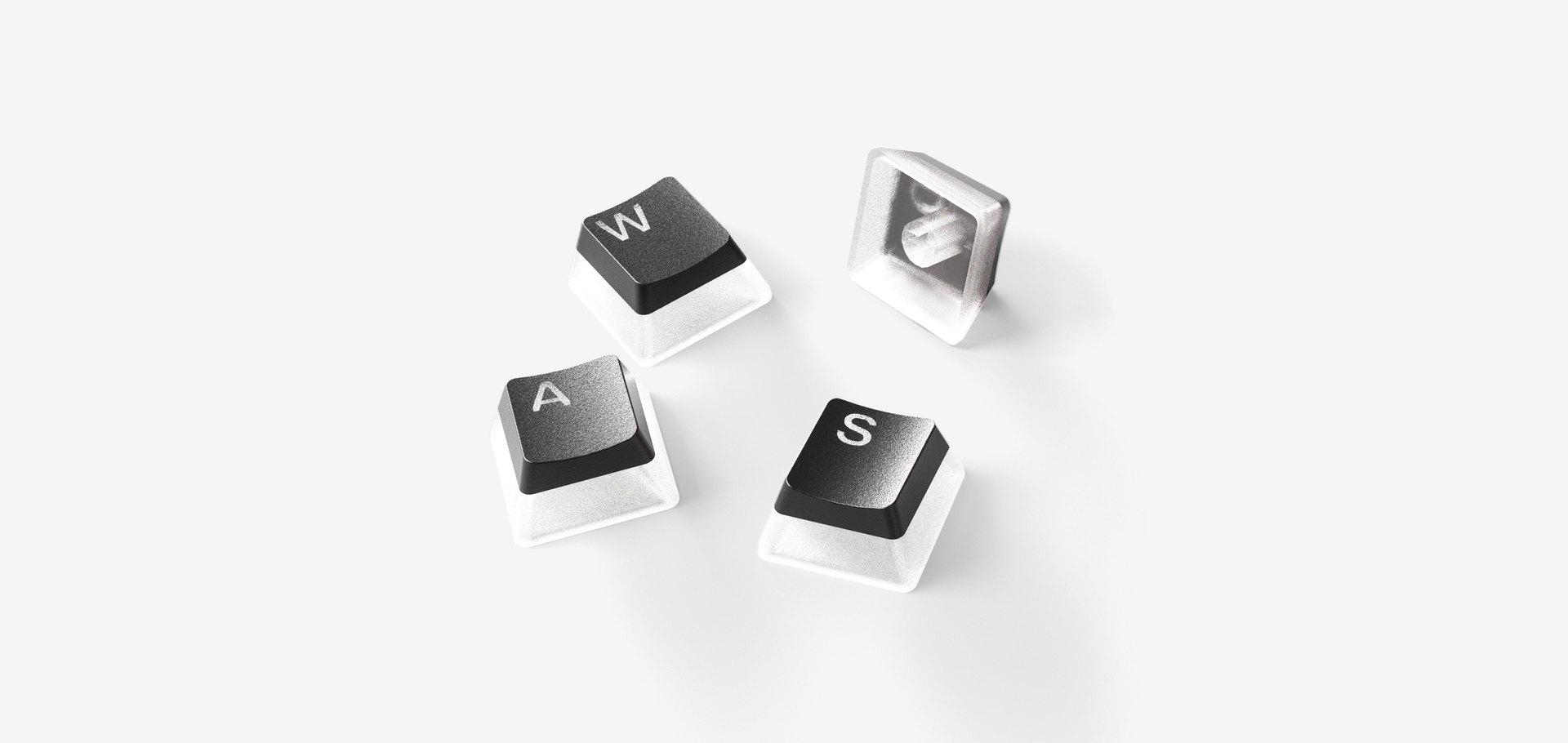 Vue rapprochée des touches de clavier PBT montrant leur texture.