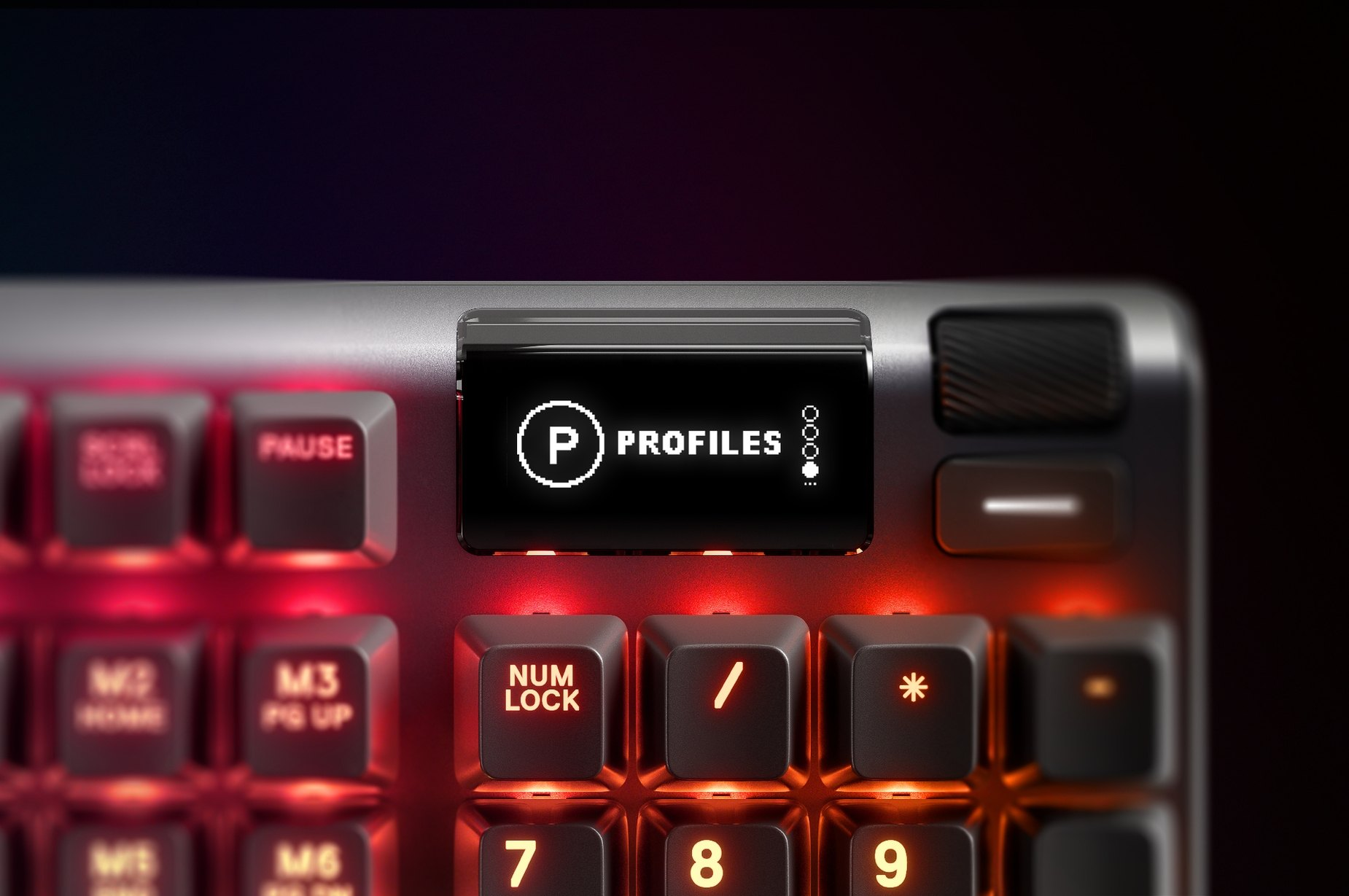 Zoomed in view of the multimedia control and volume roller on the Apex 5 gaming keyboard