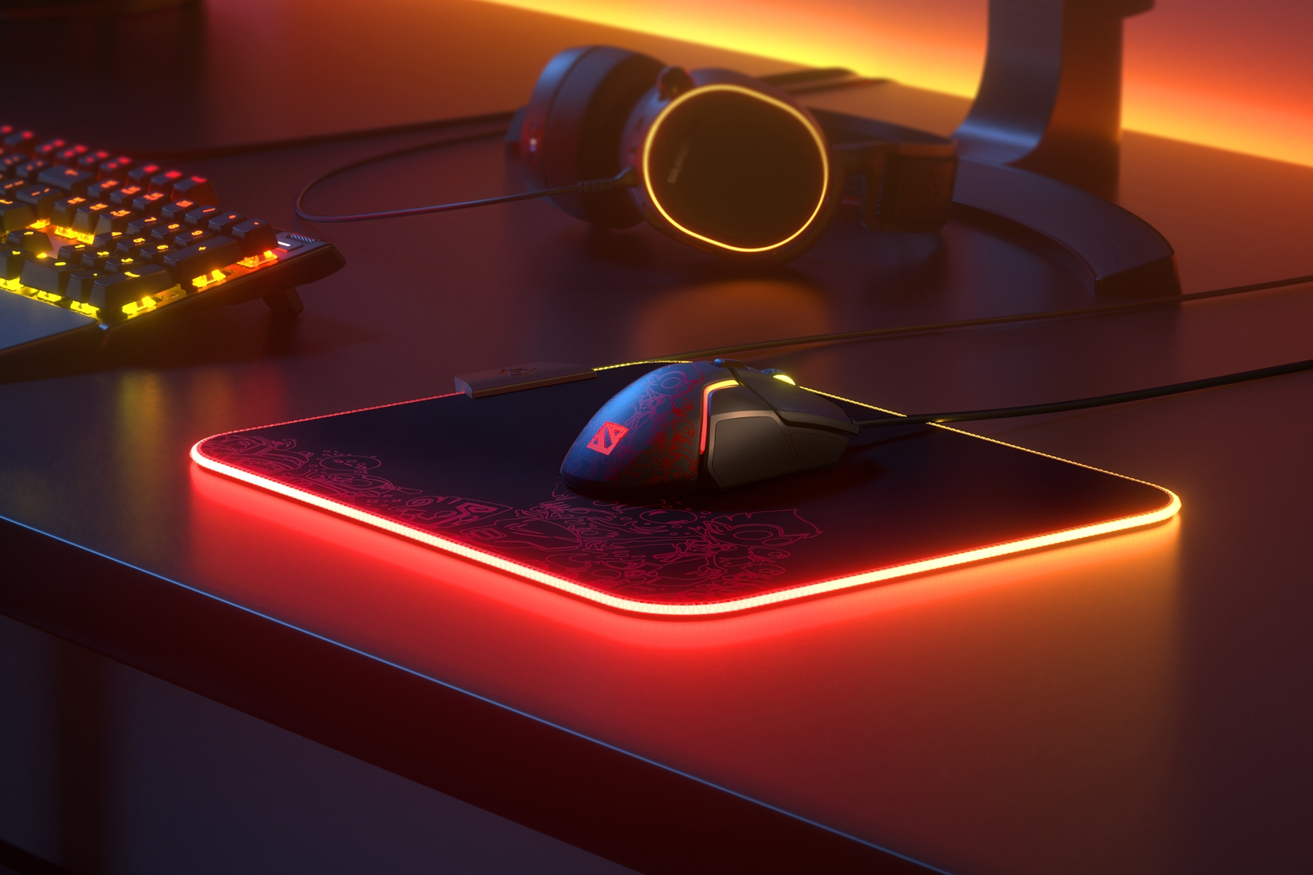 Rival 600 Dota 2 Edition on RGB mousepad with keyboard and headset