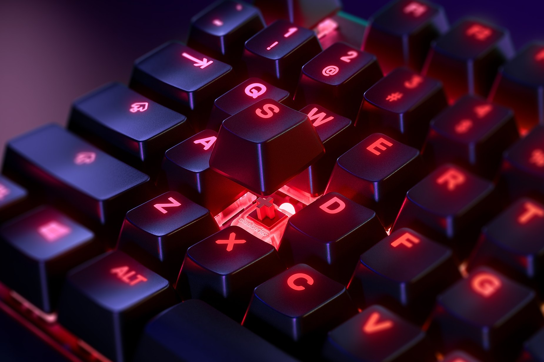 Zoomed in view of a single key on the UK English - Apex 7 TKL (Kırmızı Anahtar) gaming keyboard, the key is raised up to show the SteelSeries QX2 Mechanical RGB Switch underneath