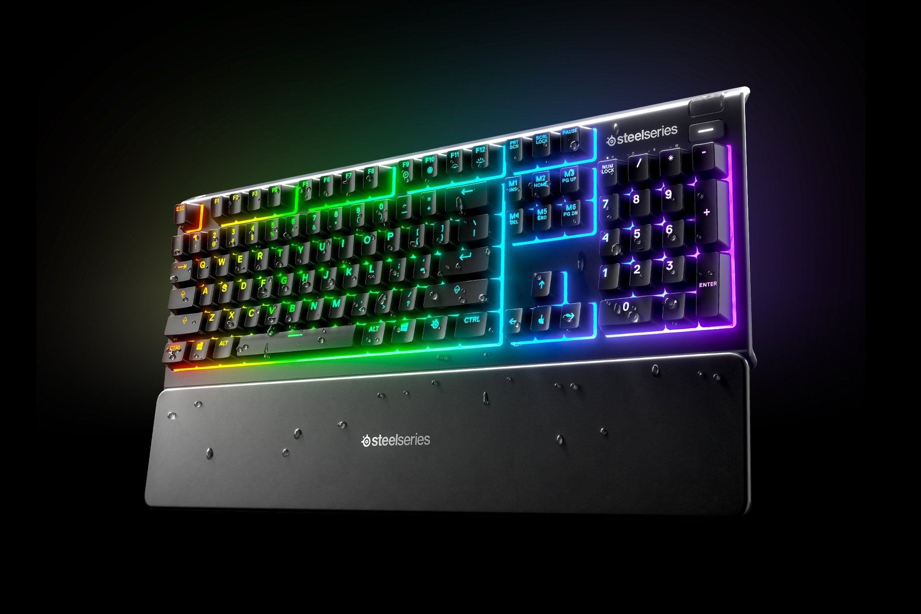 Apex 3 gaming keyboard with water droplets dripping off of it while still being illuminated to show the water resistance